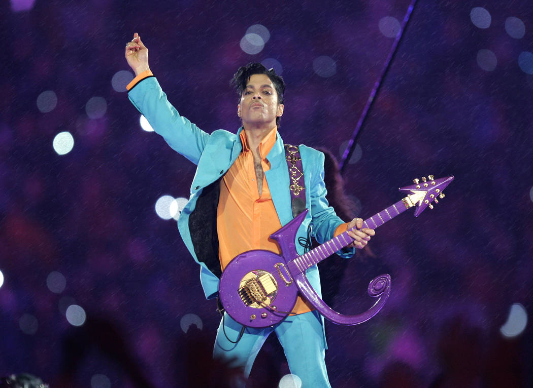 Prince performs during the halftime show at the Super Bowl XLI NFL football game at Dolphin Stadium in Miami on Feb. 4, 2007. Chris O'Meara/AP