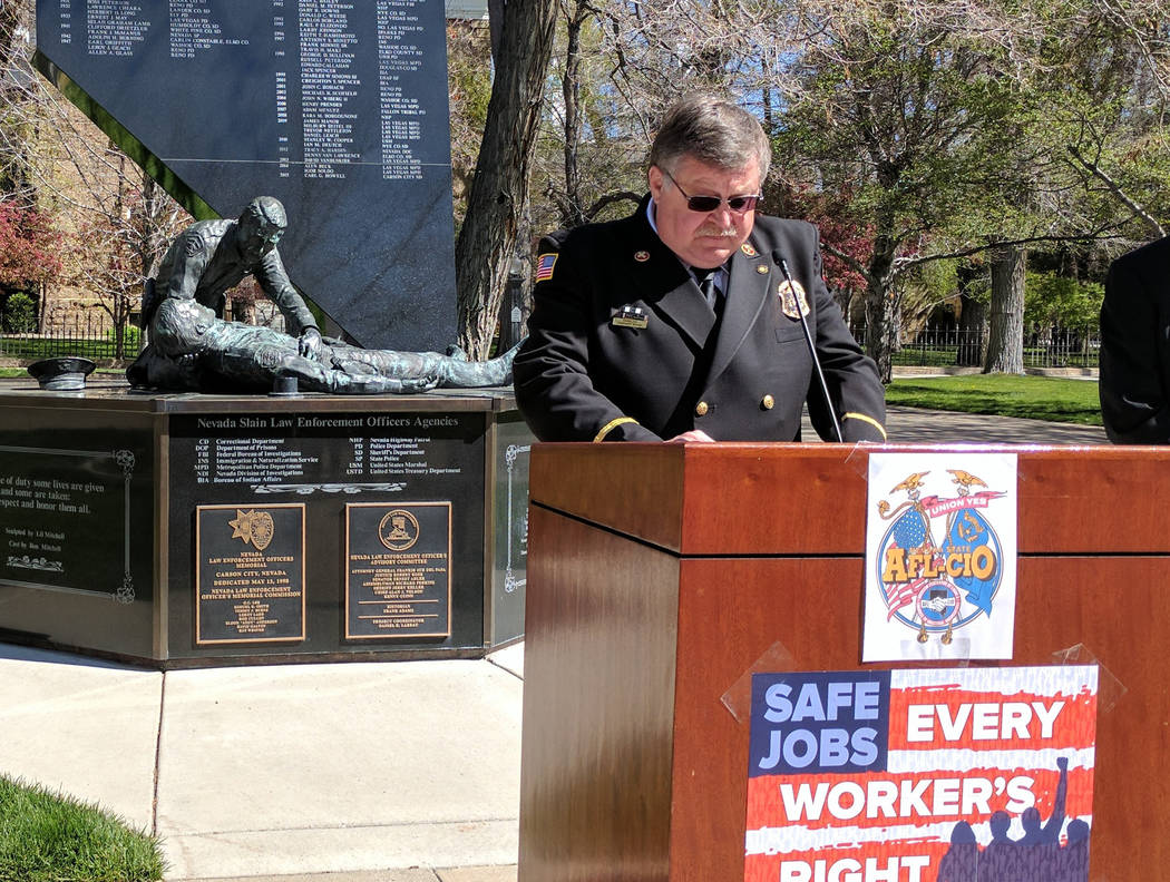 Reno Fire Department Chaplain Stephen Arvin speaking during a news conference Friday, April 21, 2017, in front of the Peace Officer Memorial in Carson City. Labor leaders urged lawmakers to pass a ...