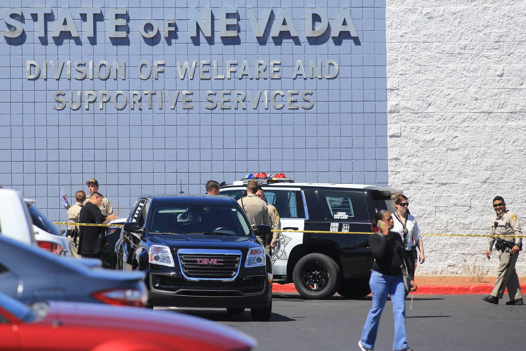 Police respond to a shooting at the State of Nevada Division of Welfare and Supportive Services on Friday, April 21, 2017. Brett Le Blanc Las Vegas Review-Journal @bleblancphoto