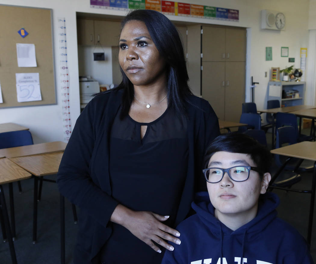 CCSD teacher Sheburra Moore-Haugsness, left, and one of her prior students Grace Kang in the teacher's classroom at Roy Martin Middle School on Tuesday, April 25, 2017, in Las Vegas. Moore-Haugsne ...