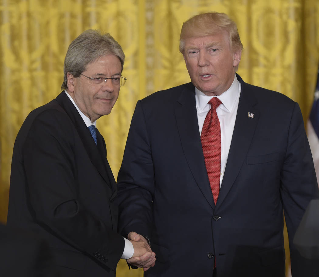 President Donald Trump, right, shakes hands with Italian Prime Minister Paolo Gentiloni, left, following their news conference in the East Room of the White House in Washington, Thursday, April 20 ...