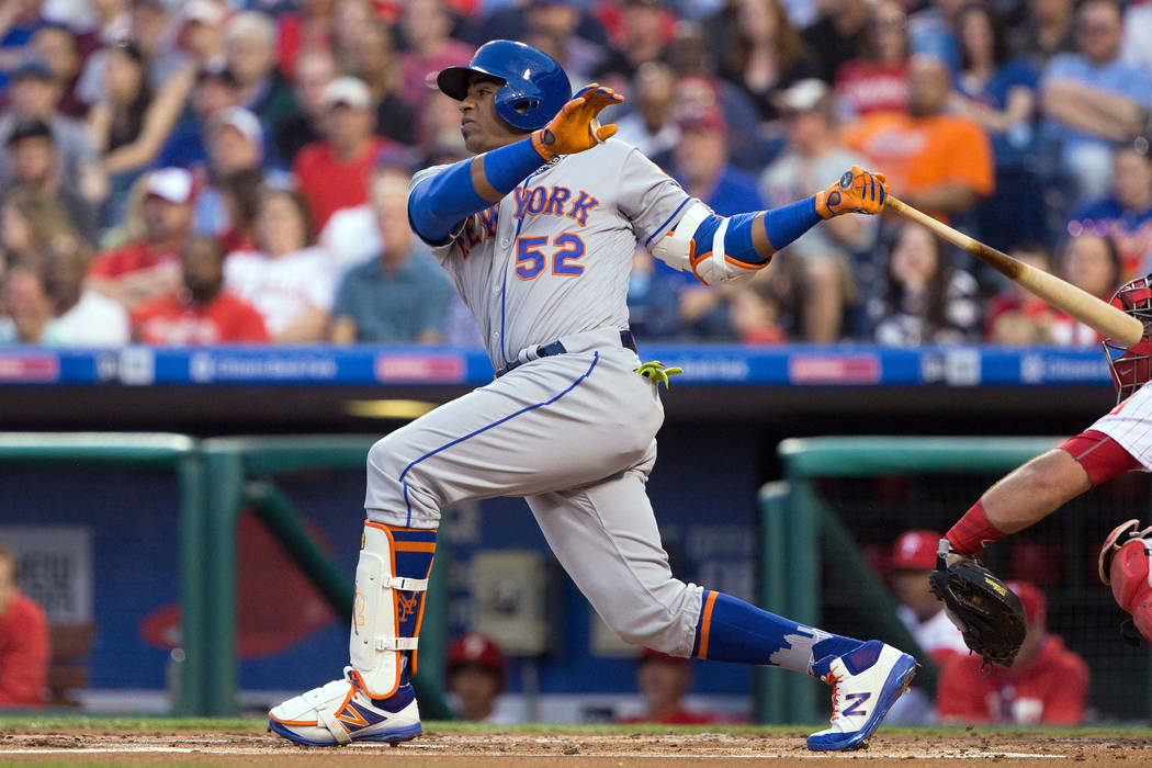 Apr 11, 2017; Philadelphia, PA, USA; New York Mets left fielder Yoenis Cespedes (52) hits a three RBI home run against the Philadelphia Phillies during the first inning at Citizens Bank Park. Mand ...
