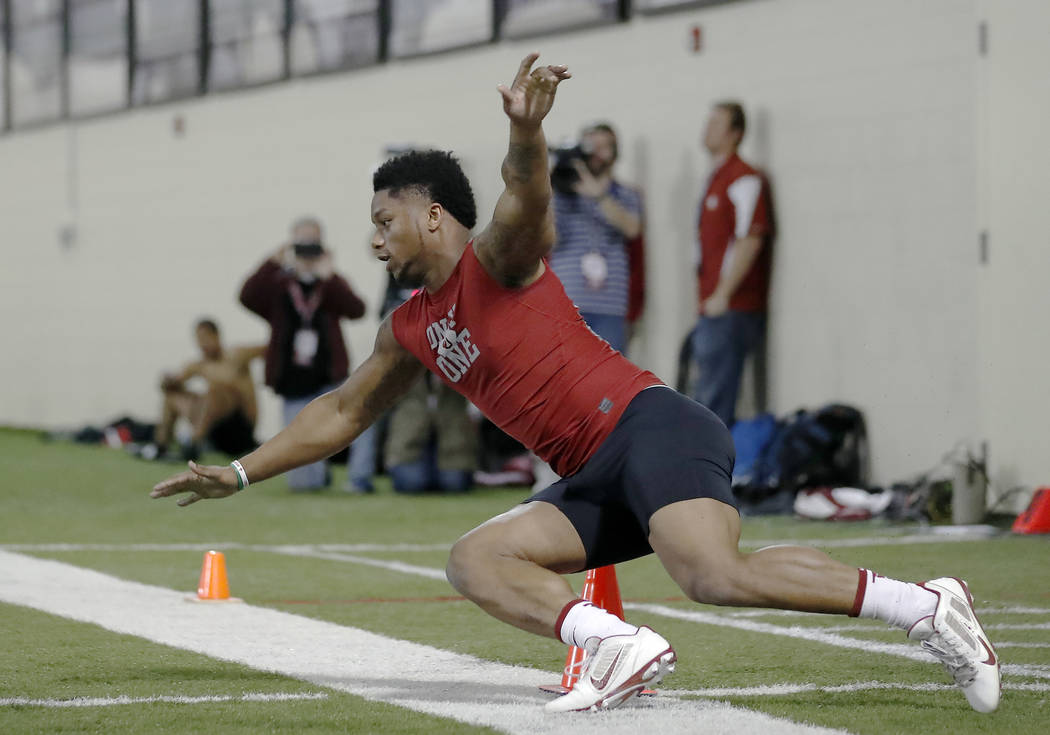 Running back Joe Mixon runs a drill at Oklahoma's Pro Day, Wednesday, March 8, 2017, in Norman, Okla. The event is to showcase players for the upcoming NFL football draft. (AP Photo/Alonzo Adams)