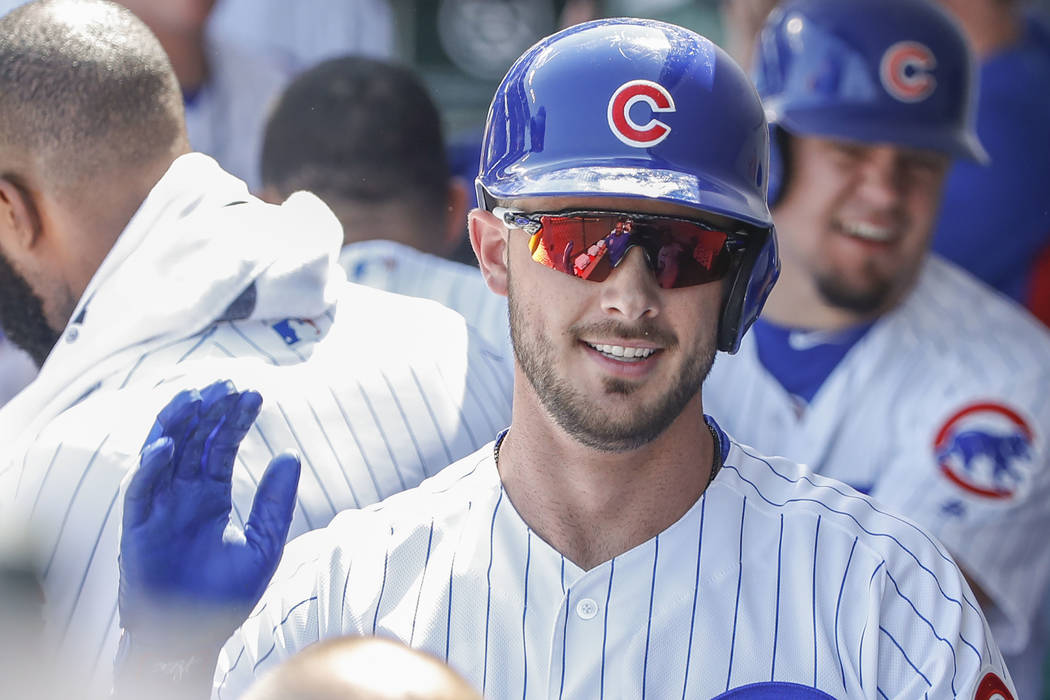 Chicago Cubs third baseman Kris Bryant celebrates with teammates in the dugout after hitting a two-run home run off Pittsburgh Pirates starting pitcher Tyler Glasnow during the first inning of a b ...