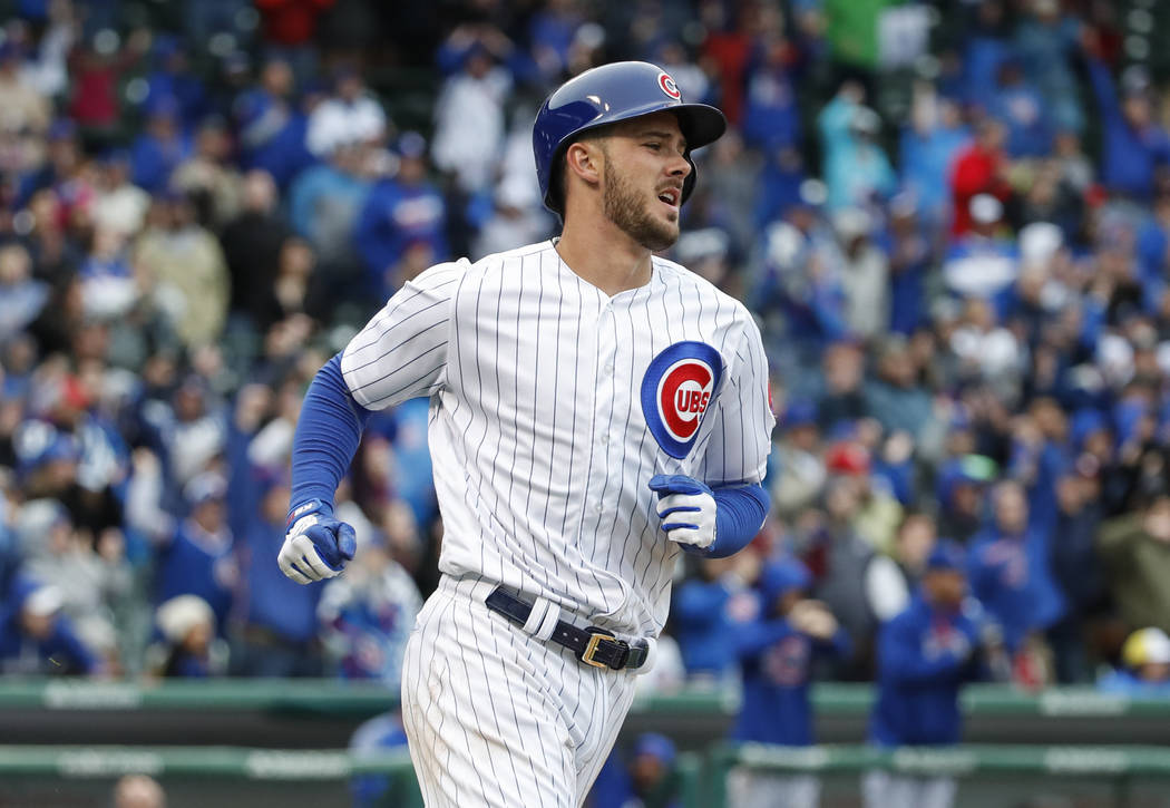 Chicago Cubs' Kris Bryant runs to a first base after hitting an RBI-single off Milwaukee Brewers relief pitcher Neftali Feliz during the ninth inning of a baseball game, Wednesday, April 19, 2017, ...
