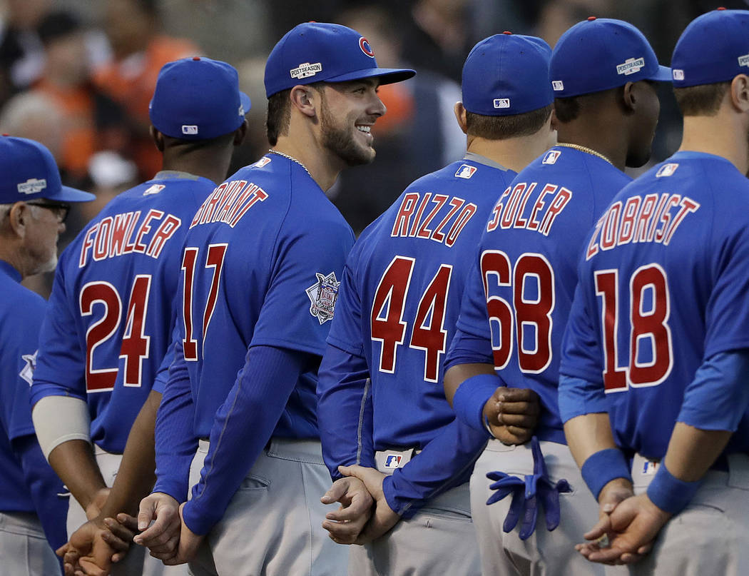 In this Oct. 10, 2016, file photo, Chicago Cubs third baseman Kris Bryant (17) smiles during introductions before Game 3 of baseball's National League Division Series against the San Francisco Gia ...