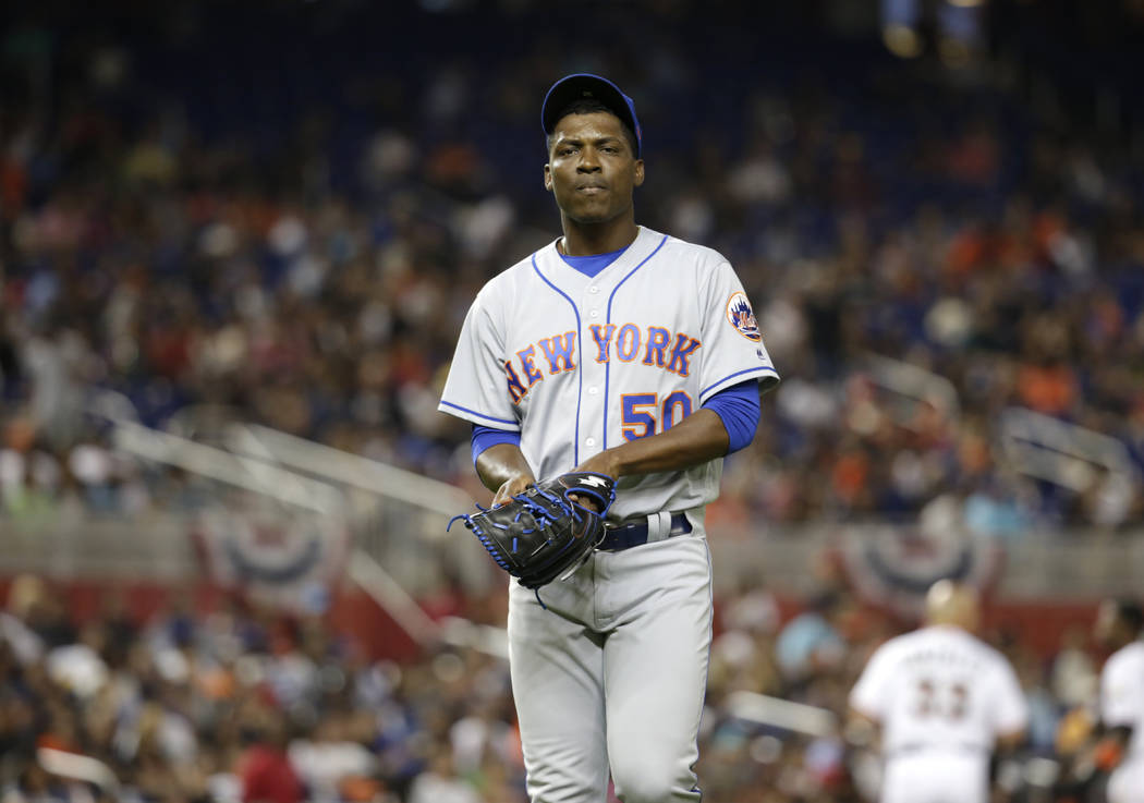 New York Mets relief pitcher Rafael Montero (50) walks to the dugout after bring relieved during the seventh inning of a baseball game against the Miami Marlins, Friday, April 14, 2017, in Miami.  ...