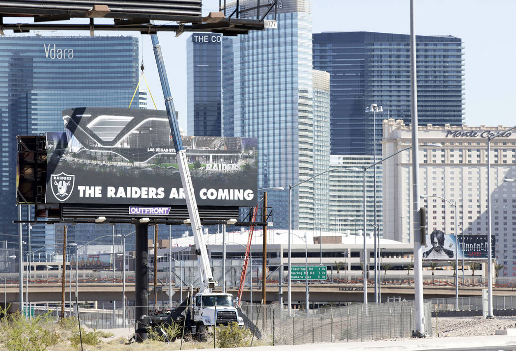 A Raiders billboard is erected on the northeast corner of Dean Martin Drive near Hacienda Avenue on Friday, April 21, 2017, at the proposed Russell Road stadium site in Las Vegas. Heidi Fang/Las V ...