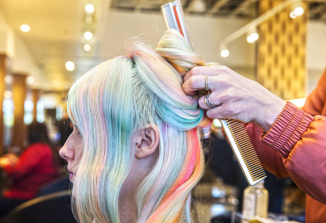 Jessica Pauli, left, gets a pastel rainbow cut from stylist Shelley Gregory on Wednesday, April 12, 2017, at Atelier by Square Salon, in Las Vegas. Gregory specializes in blonde and rainbow colore ...