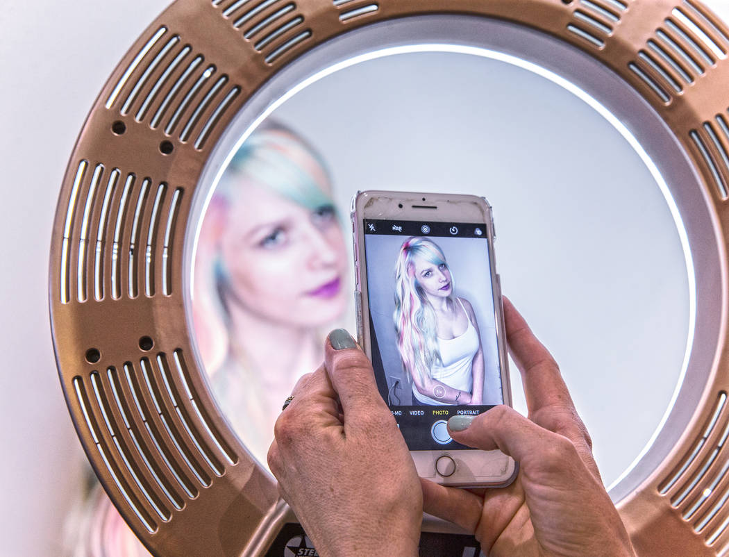Jessica Pauli gets a photo taken of her pastel rainbow cut by stylist Shelley Gregory on Wednesday, April 12, 2017, at Atelier by Square Salon, in Las Vegas. Gregory specializes in blonde and rain ...