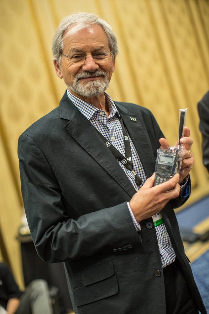 Gary Epstein, a sound engineer and product marketing manager at Dolby in California, showing off the walkie talkie he won at the Amateur Radio Operators Reception at the Westgate Hotel. (Todd Prin ...