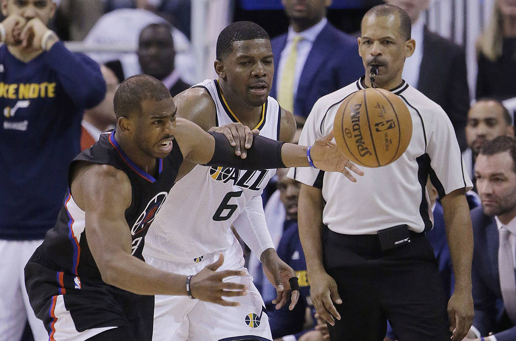 Los Angeles Clippers guard Chris Paul, left, and Utah Jazz forward Joe Johnson (6) battle for a loose ball during the first half in Game 3 of an NBA basketball first-round playoff series Friday, A ...