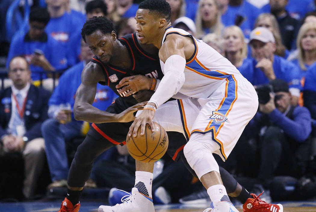 Oklahoma City Thunder guard Russell Westbrook, right, drives around Houston Rockets guard Patrick Beverley, left, in the first quarter of a first-round NBA basketball playoff game in Oklahoma City ...