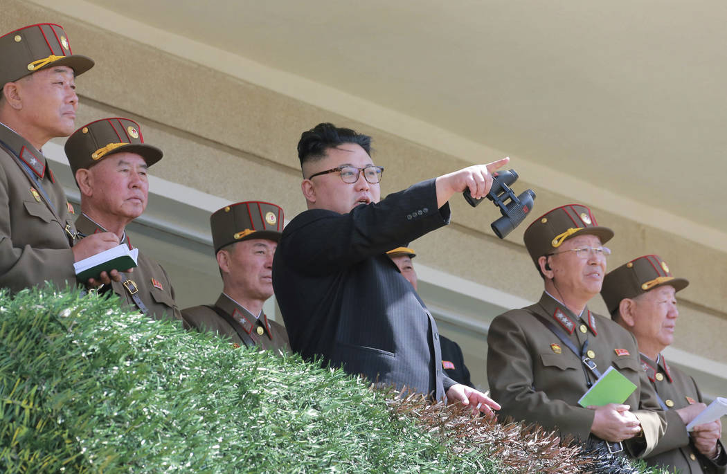 In this undated photo distributed on Friday, April 14, 2017, by the North Korean government, North Korean leader Kim Jong Un, center, watches a military drill at an undisclosed location.  Independ ...