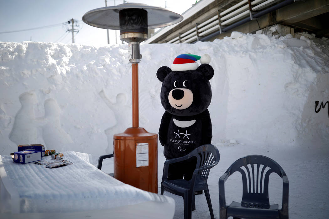 The mascot for the 2018 PyeongChang Winter Olympics Bandabi rests during the Pyeongchang Winter Festival, near the venue for the opening and closing ceremony of the PyeongChang 2018 Winter Olympic ...