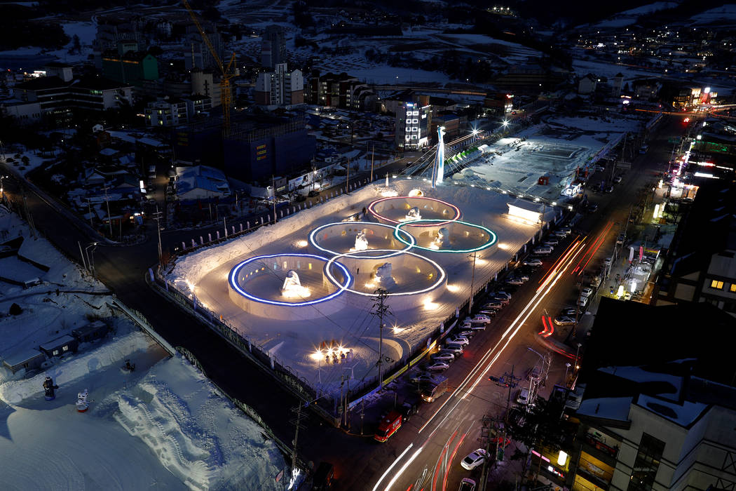 An ice sculpture of the Olympic rings is illuminated during the Pyeongchang Winter Festival, near the venue for the opening and closing ceremony of the PyeongChang 2018 Winter Olympic Games in Pye ...