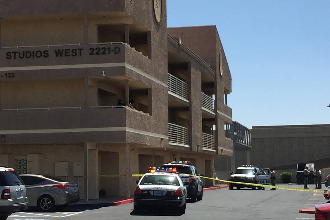 Metropolitan Police Department squad cars sit outside the Bonanza Park Studio apartment complex, 2221 W. Bonanza Road on Sunday. Las Vegas police say a woman was left dead and a man critically inj ...
