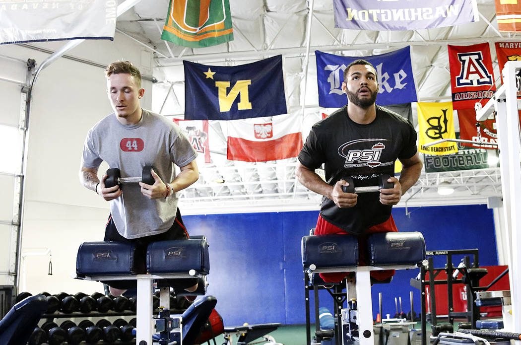 Troy Hawthorne, left, and Andrew Price, former UNLV football players who have entered the draft, exercise at Philippi Sports Institute on Tuesday, April 25, 2017, in Las Vegas. Bizuayehu Tesfaye L ...