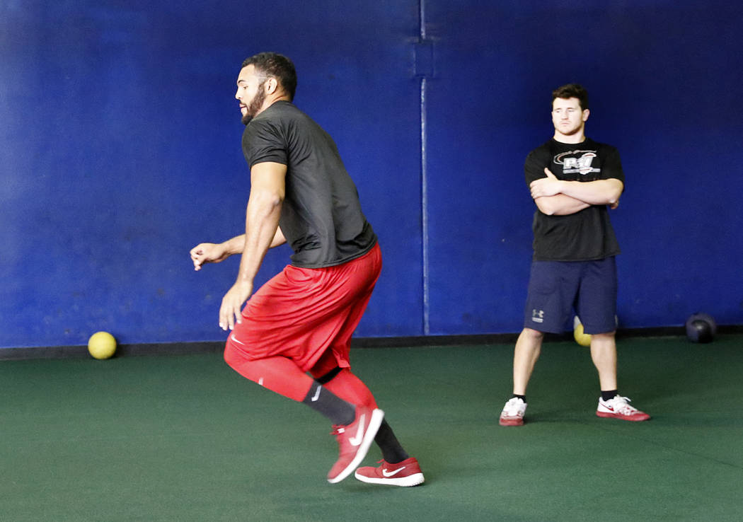 Andrew Price, former UNLV football player who has entered the draft, exercises as Mark Philippi, right, physical training instructor at Philippi Sports Institute looks on Tuesday, April 25, 2017,  ...