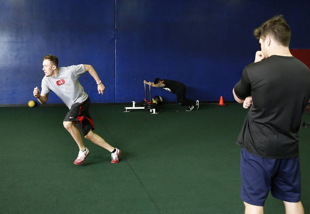 Troy Hawthorne, former UNLV football player who has entered the draft, exercises as Mark Philippi, right, physical training instructor at Philippi Sports Institute looks on Tuesday, April 25, 2017 ...