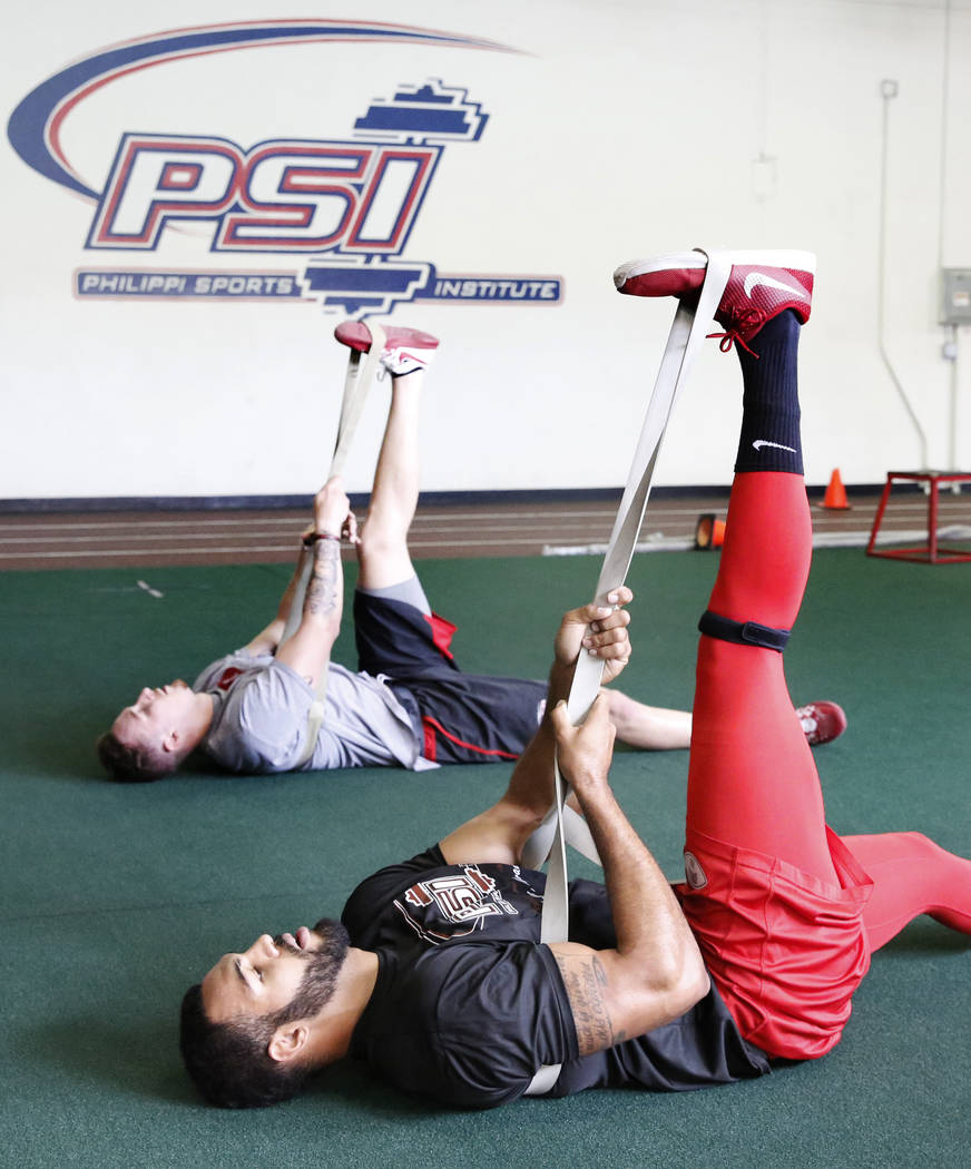 Andrew Price, front, and Troy Hawthorne, former UNLV football players who have entered the draft, exercise at Philippi Sports Institute on Tuesday, April 25, 2017, in Las Vegas. Bizuayehu Tesfaye  ...