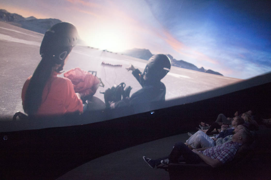 An audience watches a movie preview Thursday, April 27, 2017, inside the Dome, a 360 theatre that will be showing six different films to the public at the Container Park in Downtown Las Vegas. Rac ...