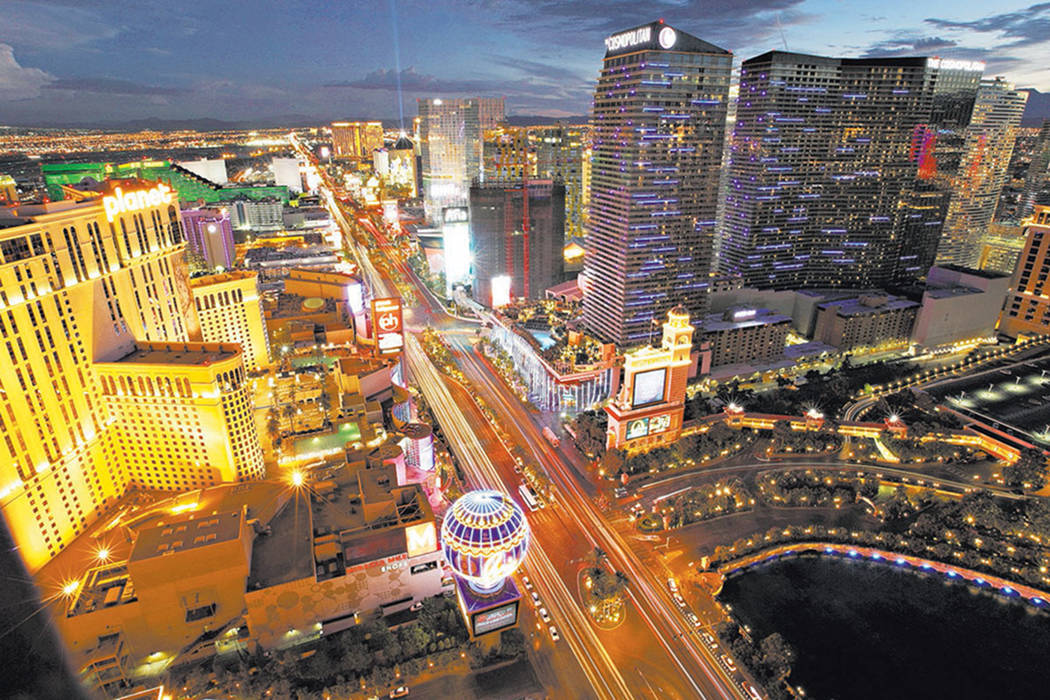The lights of cars blur along Las Vegas Boulevard in Las Vegas. (The Associated Press file)