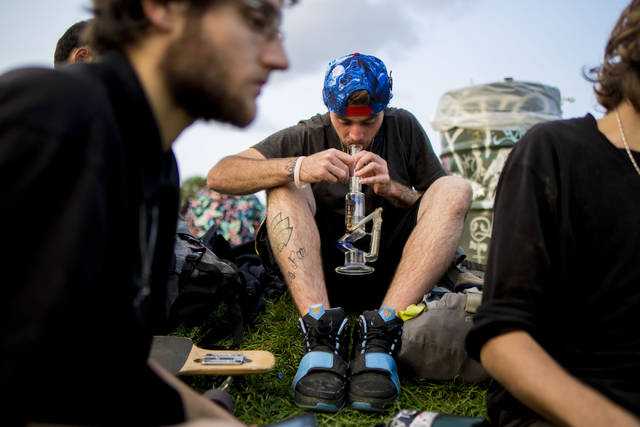 Teenagers take turns to smoke marijuana in Commons Park, Wednesday, Aug. 31, 2016, in Denver. Elizabeth Page Brumley Las Vegas Review-Journal Follow @ELIPAGEPHOTO
