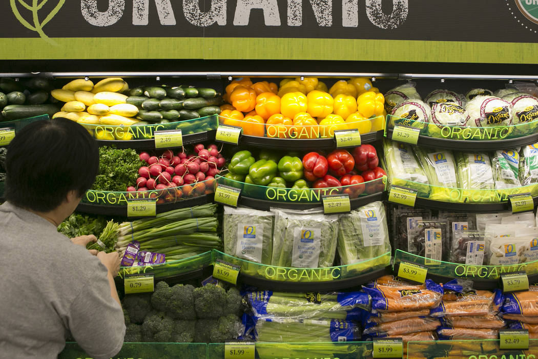 A customer browses organic produce during the grand opening of Albertsons on Blue Diamond Road on Wednesday, April 26, 2017, in Las Vegas. Bridget Bennett  Las Vegas Review-Journal @bridgetkbennett