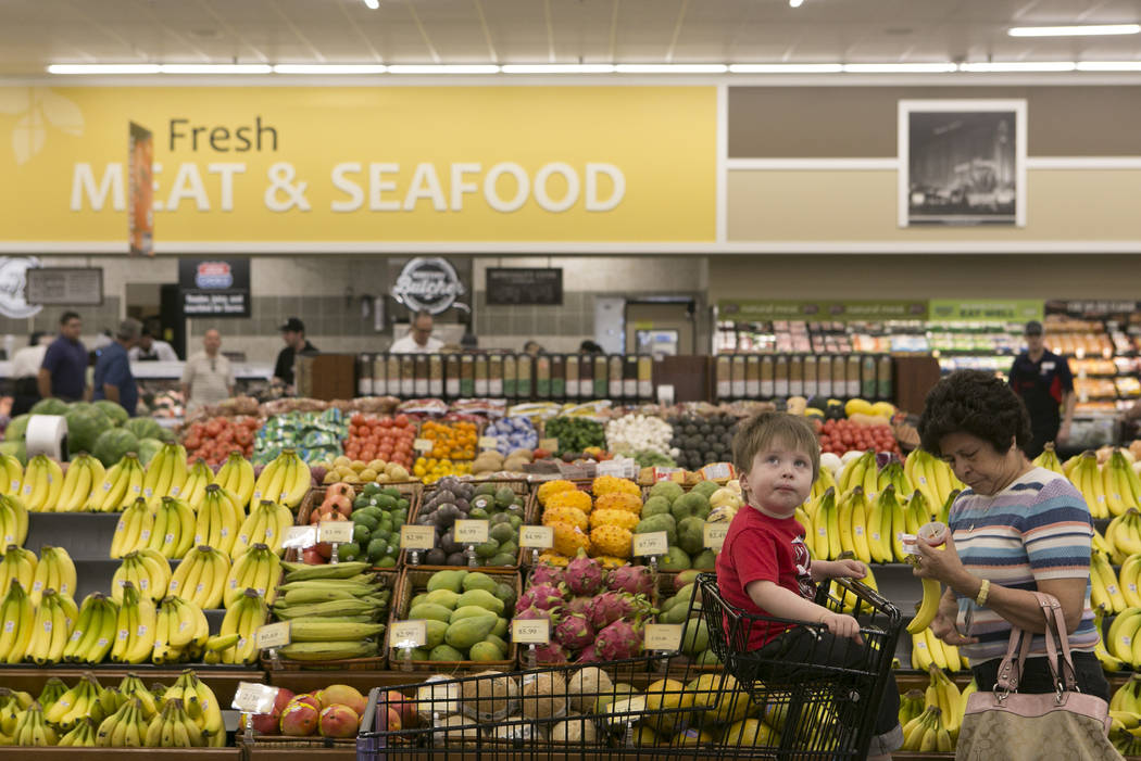 Customer Malenea Green, right, and her grandson Charlie make their way through the produce section during the grand opening of Albertsons on Blue Diamond Road on Wednesday, April 26, 2017, in Las  ...