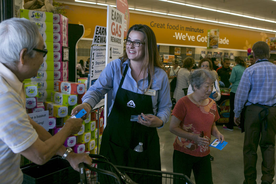 Customer service manager Cathy Budginas greets patrons as they enter during the grand opening of Albertsons on Blue Diamond Road on Wednesday, April 26, 2017, in Las Vegas. Bridget Bennett  Las Ve ...