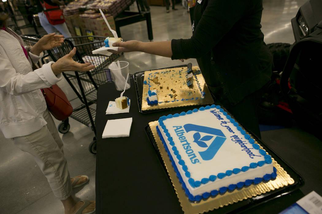 Cake is handed out in celebration of the grand opening of Albertsons on Blue Diamond Road on Wednesday, April 26, 2017, in Las Vegas. Bridget Bennett  Las Vegas Review-Journal @bridgetkbennett