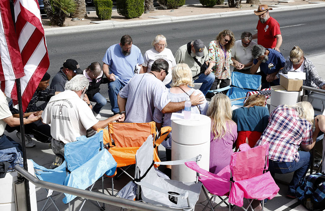 Supporters pray outside the Lloyd George U.S. Courthouse while awaiting the jury's verdict in the first Bunkerville standoff trial on Monday, April 24, 2017, in Las Vegas. Bizuayehu Tesfaye Las Ve ...