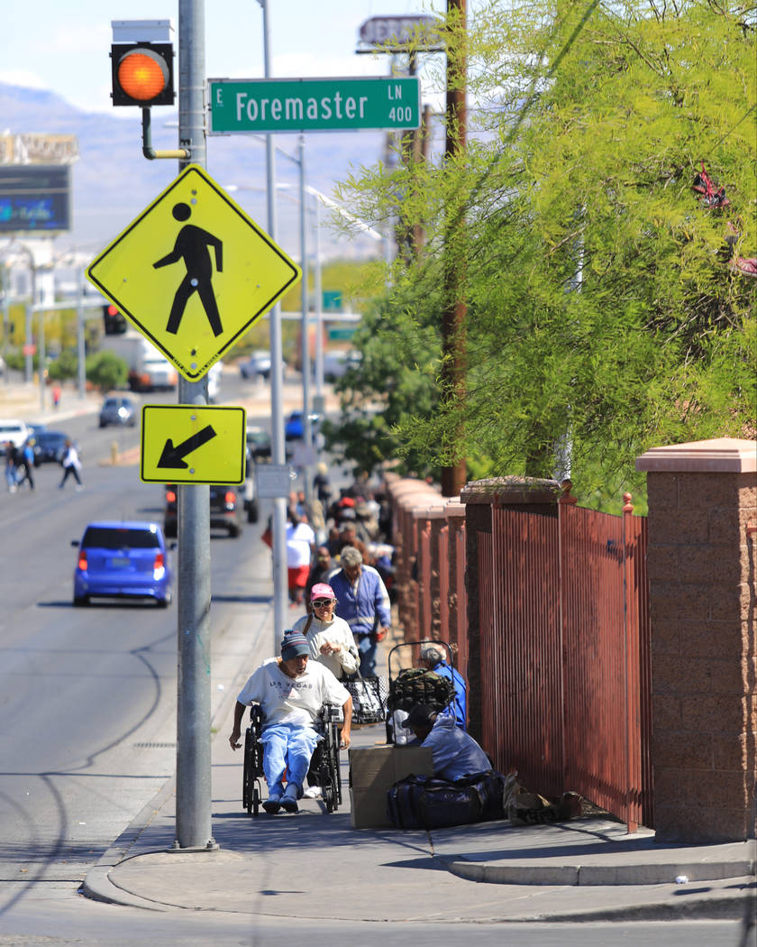People walk along Main Street at Foremaster Lane in Las Vegas, on Friday, April 28, 2017, in front of land that the city of Las Vegas wants to turn into a campus that will bring homeless providers ...