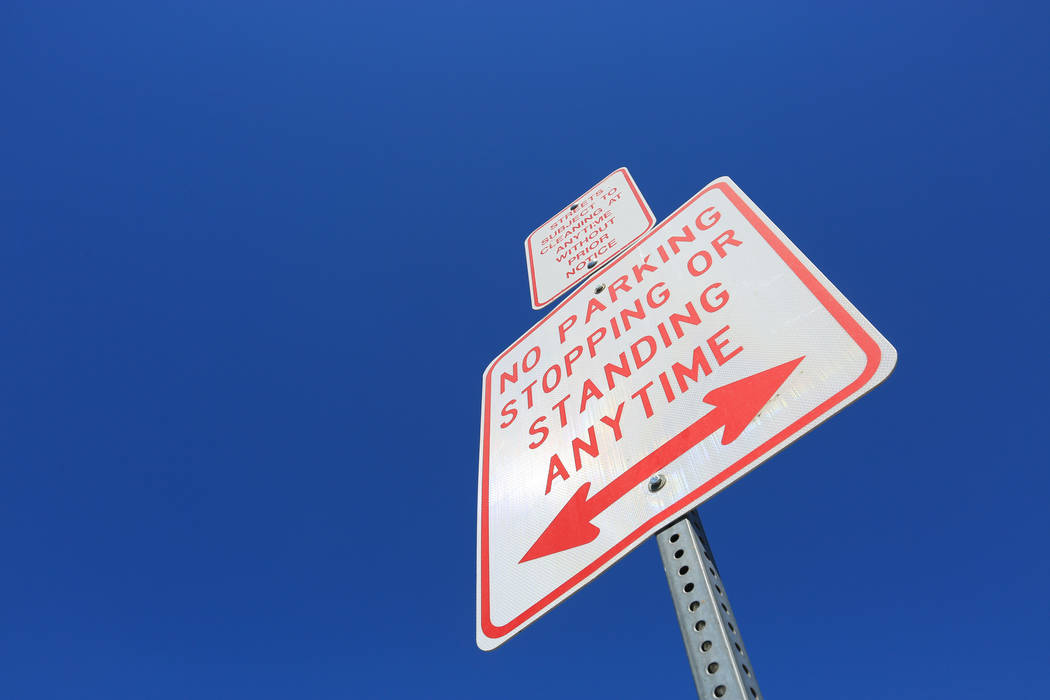 A sign warning people not to stop stand above the sidewalk on Foremaster Lane in Las Vegas, on Friday, April 28, 2017, in front of land that the city of Las Vegas wants to turn into a campus that  ...