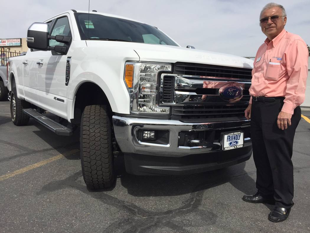 Friendly Ford Friendly Ford sales consultant Joe Nazmi is seen with a 2017 Ford Super Duty truck at the dealership situated at 660 N. Decatur Blvd.