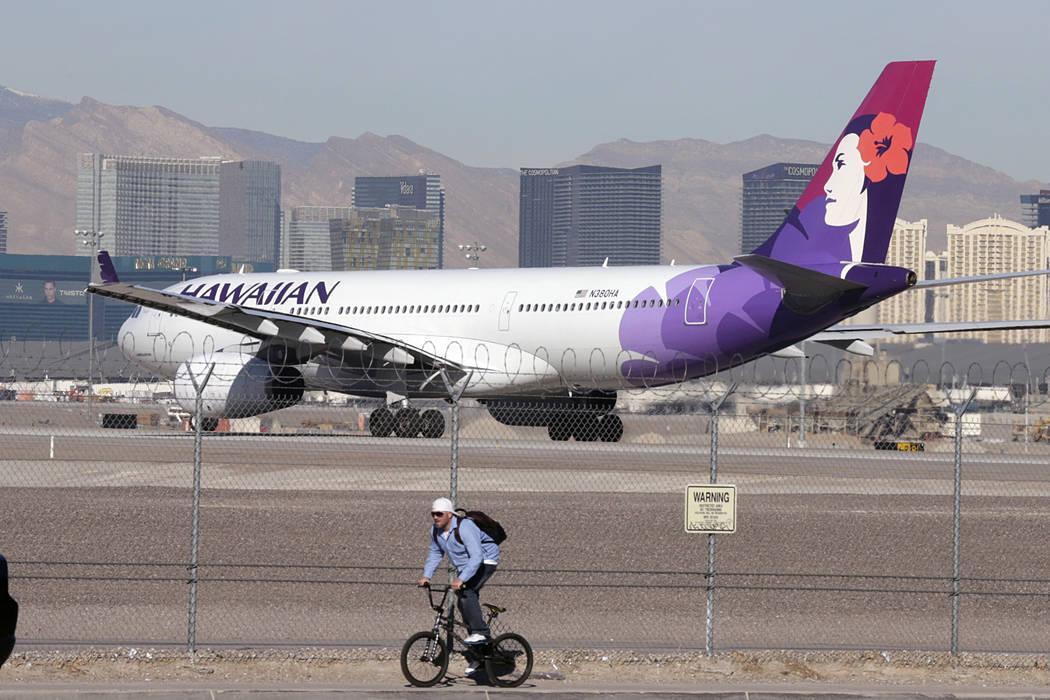 A Hawaiian Airlines plane prepares to take off from McCarran International Airport on Wedesday, Feb. 15, 2017, in Las Vegas. (Bizuayehu Tesfaye/Las Vegas Review-Journal) @bizutesfaye