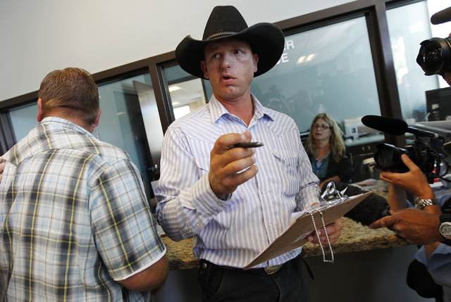 Ryan Bundy, son of rancher Cliven Bundy, gets the paperwork necessary to file official complaints and press charges against federal law enforcement agents stemming from last months failed cattle r ...