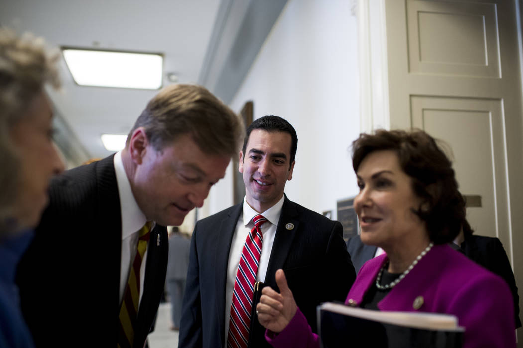Rep. Ruben Kihuen, D-Nev., center, meets with Sen. Dean Heller, R-Nev., and Rep. Jacky Rosen, D-Nev., after making statements in opposition to using Yucca Mountain as a nuclear waste disposal site ...