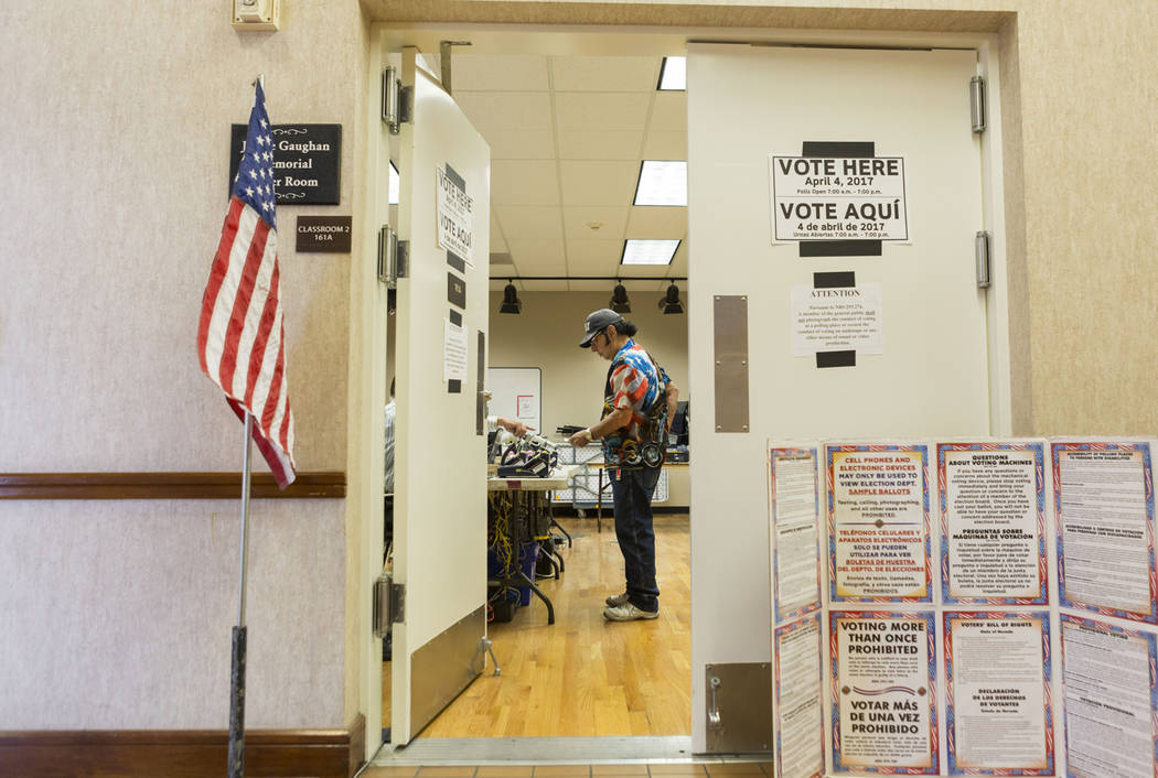 Robert Ranyan signs in to cast his ballot for the municipal primary elections at the East Las Vegas Community Center in Las Vegas on April 4. The Nevada Senate approved several election-related me ...