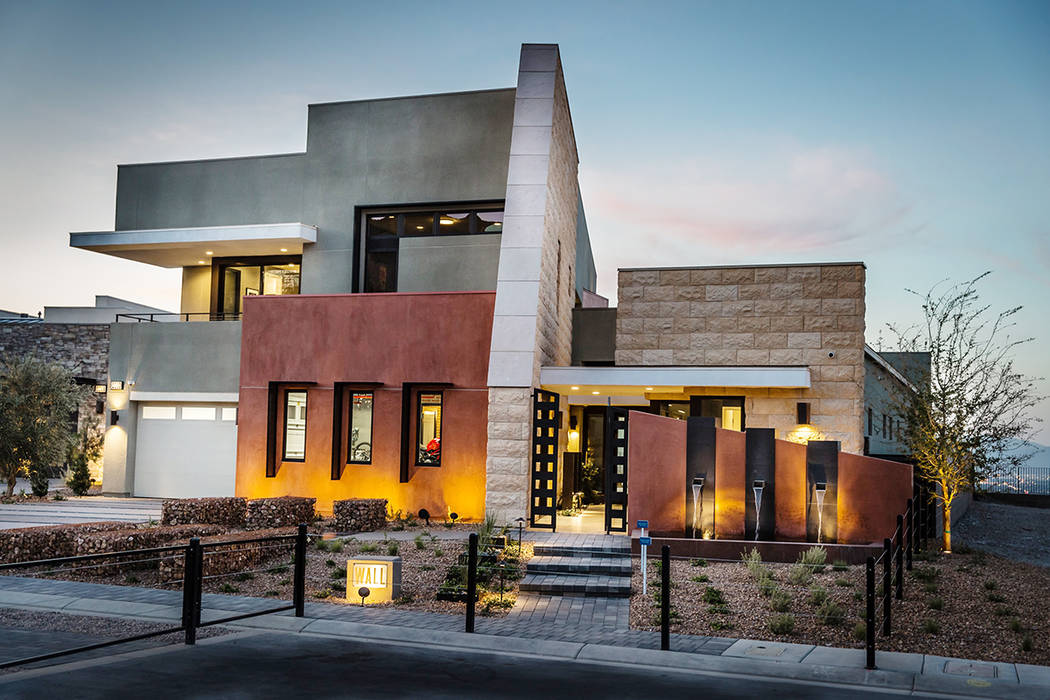 The Wall model features a two-story rock wall architectural element that anchors and defines the home's exterior. (Pardee Homes)