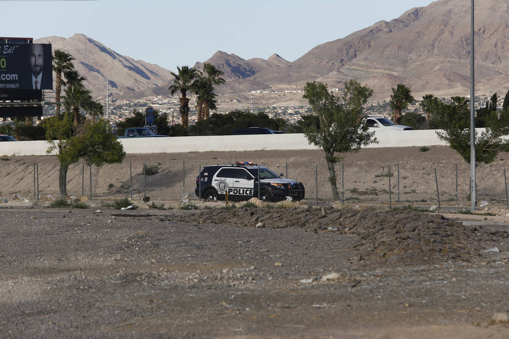 A Las Vegas Metropolitan police officer investigate where a decaying body was found in a vacant lot located near 7745 Boulder Highway on Tuesday, April 25, 2017, in Las Vegas. Christian K. Lee Las ...