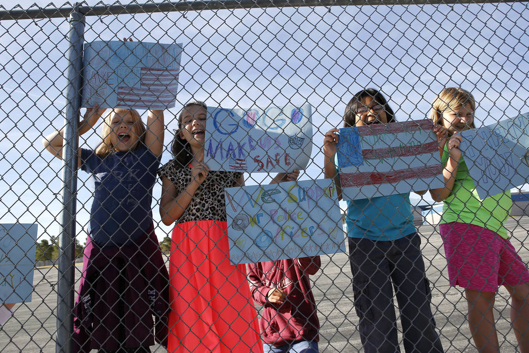 Marc A. Kahre Elementary School students cheer on police officers as they run the 18th annual Nevada law enforcement officers memorial run on Wednesday, April 26, 2017, in Las Vegas. Christian K.  ...