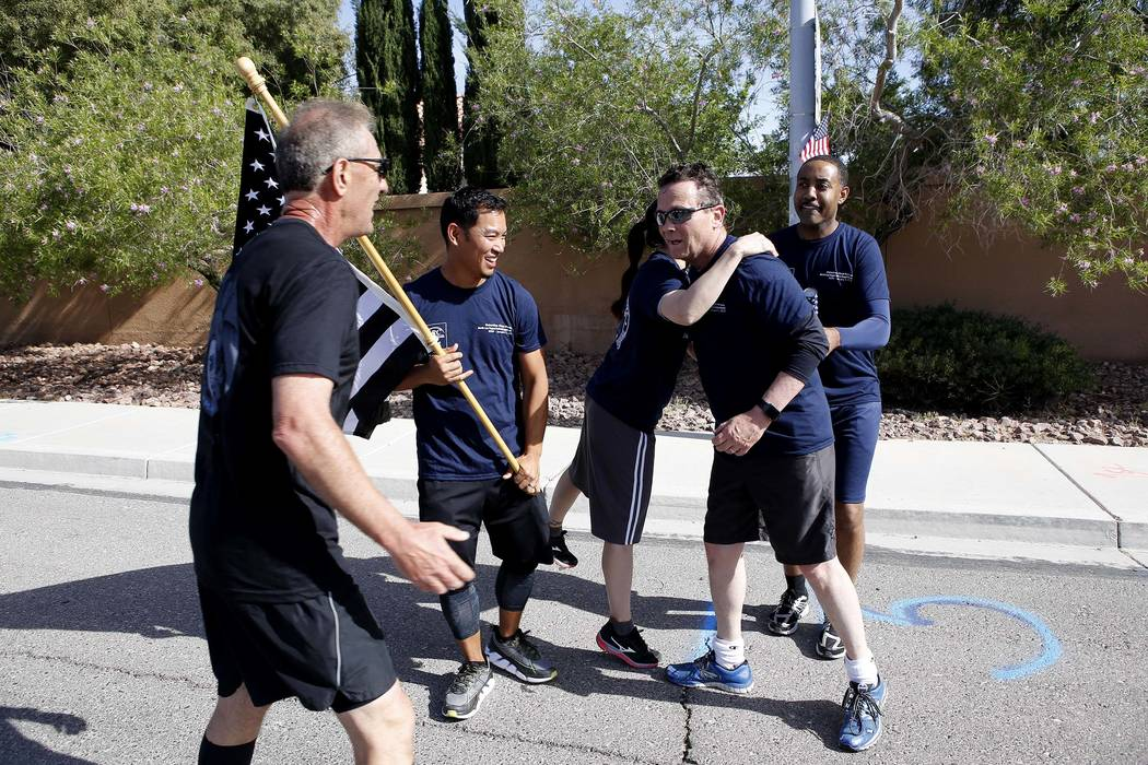Runners hand off the flag and baton to the next group during the 18th annual Nevada law enforcement officers memorial run Wednesday, April 26, 2017, in Las Vegas. Christian K. Lee Las Vegas Review ...