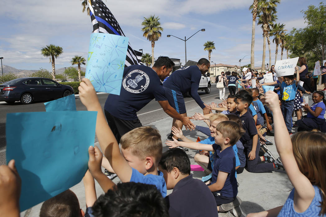 Police officers greet students as they cheer them on during the 18th annual Nevada law enforcement officers memorial run on Wednesday, April 26, 2017, in Las Vegas. Christian K. Lee Las Vegas Revi ...
