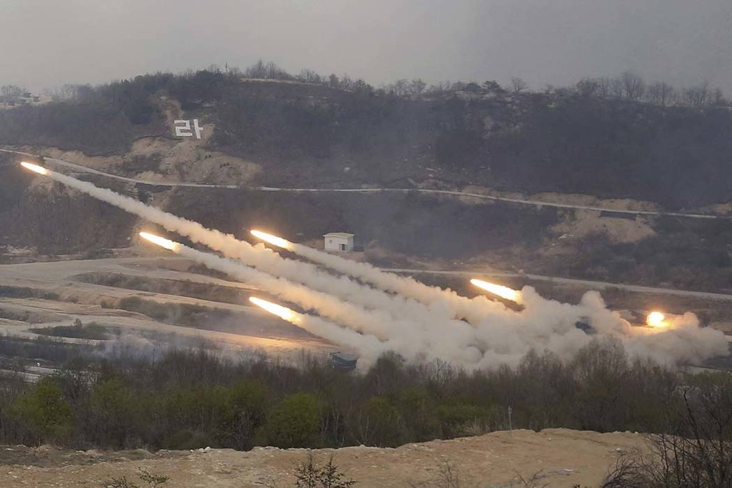 South Korean army's multiple launch rocket systems fire rockets during South Korea-U.S. joint military live-fire drills at Seungjin Fire Training Field in Pocheon, South Korea, near the border wit ...
