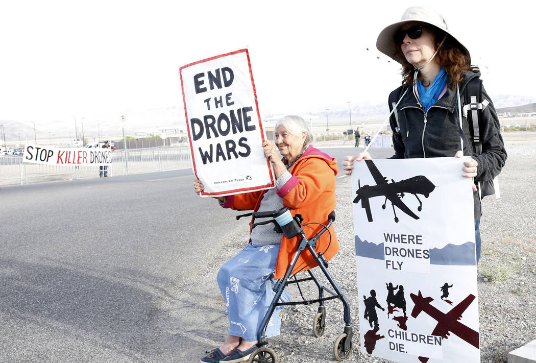 Anti-drone warfare protesters, Mary Dean, left, and Lavelle Waters protest outside Creech Air Force Base at Indian Springs on Monday, April 24, 2017, to honor the 15 civilian Afghan men killed by  ...