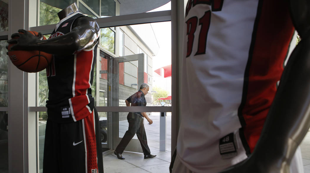 UNLV basketball coach Marvin Menzies walks out of the Mendenhall Center after speaking to members of the media on Wednesday, April 26, 2017, in Las Vegas. Menzies discussed his recruiting class. C ...
