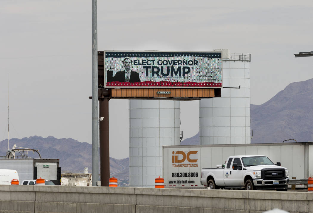 A digital billboard off Interstate 15 in Las Vegas Tuesday compares Nevada Attorney General Adam Laxalt to President Donald Trump. Although he has not announced his intentions, Laxalt is said to b ...