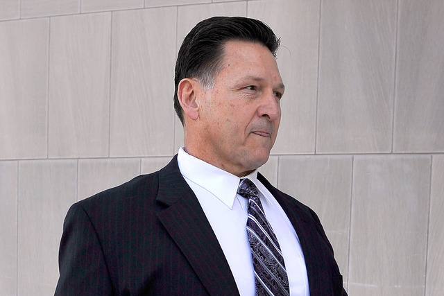 Former Family Court Judge Steven Jones arrives at the Lloyd George U.S. Courthouse in Las Vegas on Feb. 25, 2015. Jones was sentenced to 26 months in prison in a nearly $3 million investment schem ...